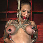 Big tits roped and tortured with pins and heavy weights. Painful breasts tortures
