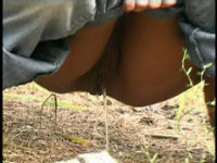 teen peeing in forest