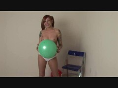 Hot chick in pigtails plays with balloons