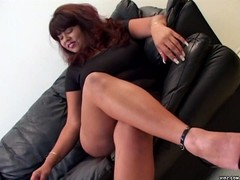 Plump smoking whore teases lover on couch