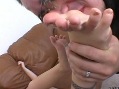 Petite blonde receives stimulating foot job