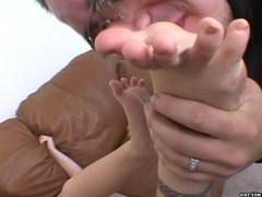 Petite blonde receives stimulating foot job