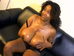 Black ho Chaka lubed her megaboobs and pussy