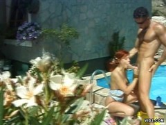 Redhead slut gets fucked while suntanning