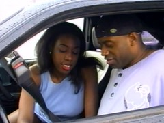 Black slut fucks in a car
