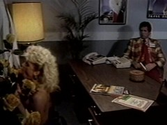 Blonde chick fucks over the table