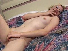 Gorgeous blonde pleasures self by caressing her tits and pussy