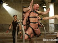 Two studly slaves gets tied up, used and abused by Christian Wilde during a live show