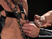 Two comic heroes studs fight and fuck in bondage
