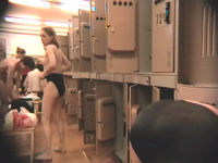 blonde puts on underwear in changeroom