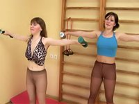 Two babes exercise in pantyhose at the gym